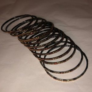 NWOT! Set of 14 bangles. Color is gold and red.